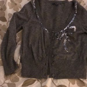 Grey sweater with sequence bow . Worn once